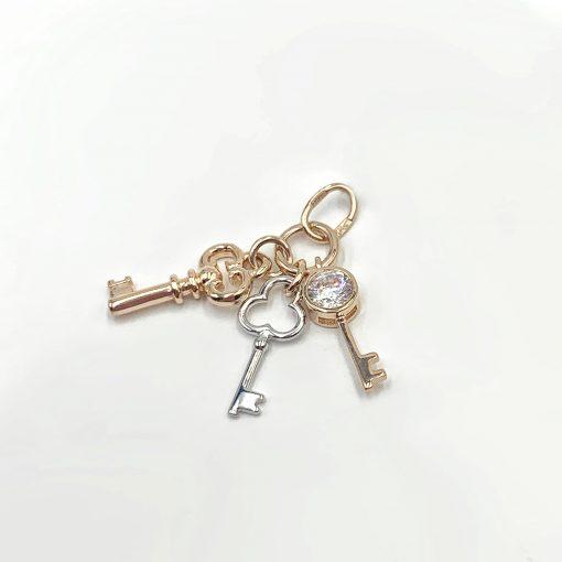 Золота підвіска ключик
