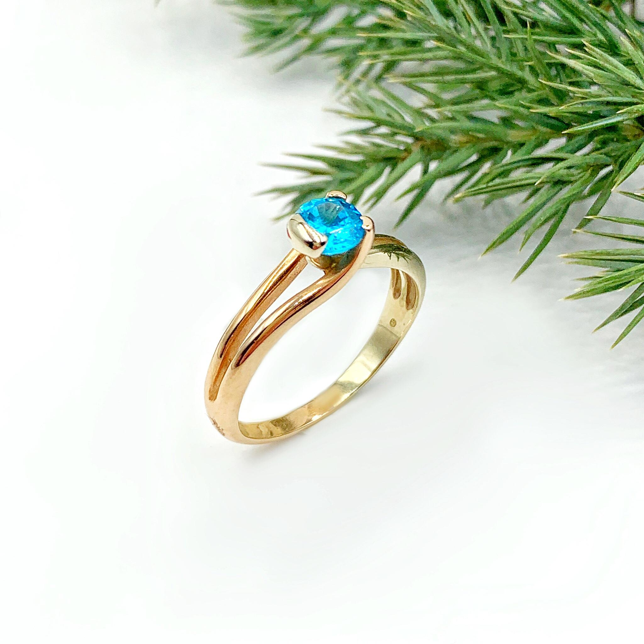 Золота каблучка з блакитним фіанітом